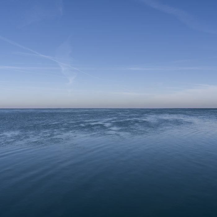 Fine Art Photography of Lake Michigan still and deep blue from Chicago by Contemporary Photographer Lincoln Schatz