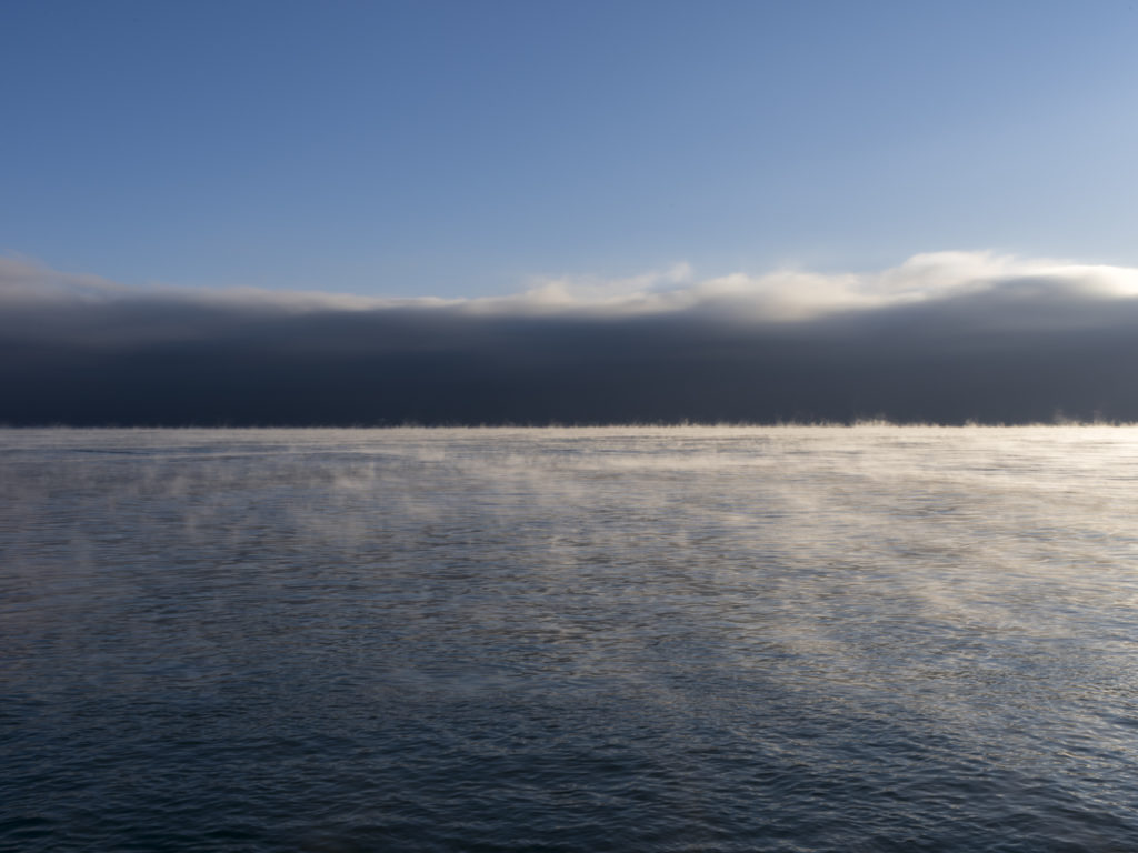 Fine Art Photography of Lake Michigan cold with steam rising from Chicago by Contemporary Photographer Lincoln Schatz