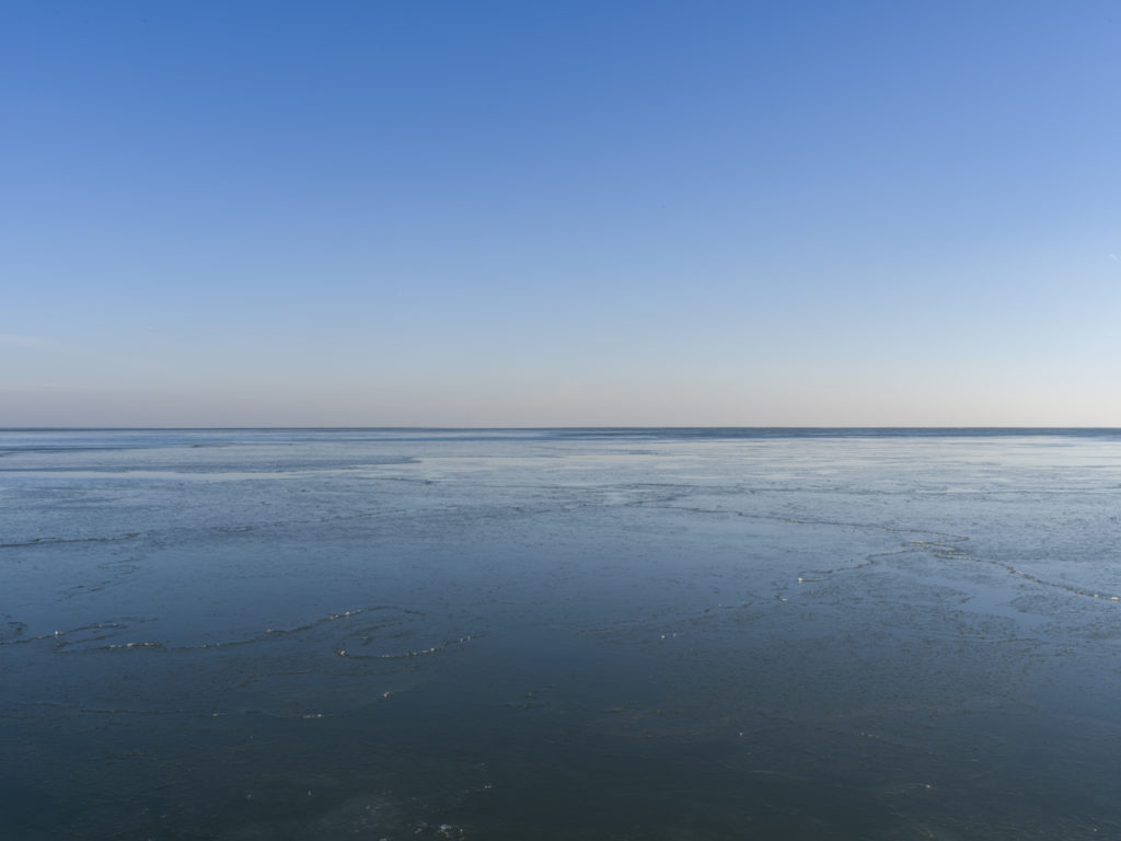 Fine Art Photography of Lake Michigan with thin ice from Chicago by Contemporary Photographer Lincoln Schatz