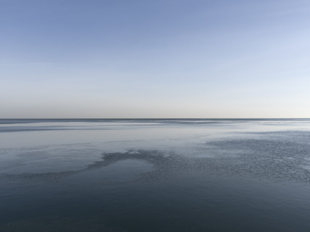 Fine Art Photography of Lake Michigan still and blue from Chicago by Contemporary Photographer Lincoln Schatz