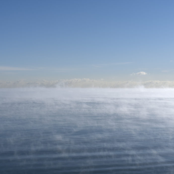 steam rising off lake in sub zero temperatures Contemporary art photograph of Lake Michigan, the inland sea, from Chicago by artist Lincoln Schatz