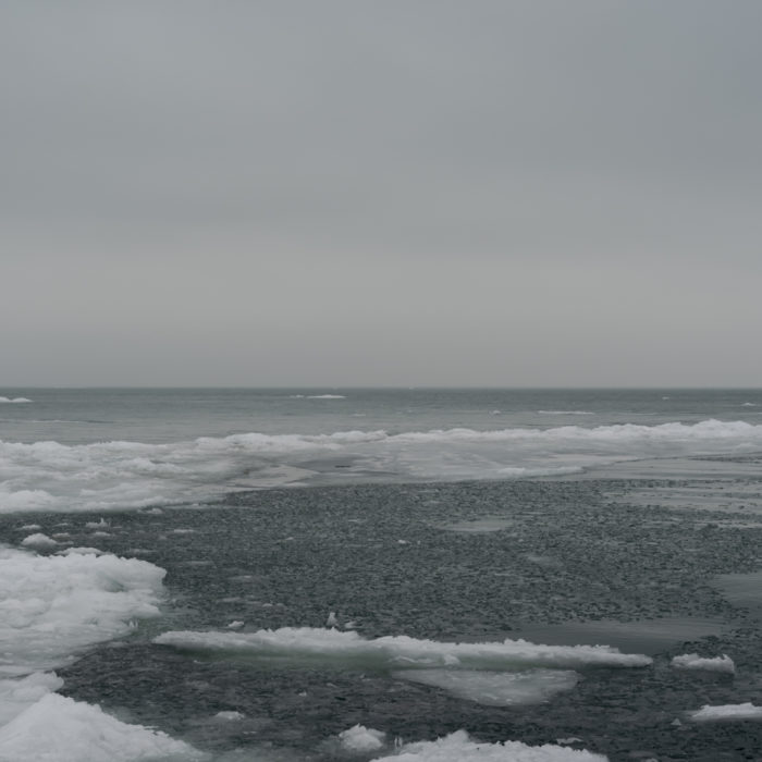 Ice forms undulatingContemporary art photograph of Lake Michigan, the inland sea, from Chicago by artist Lincoln Schatz