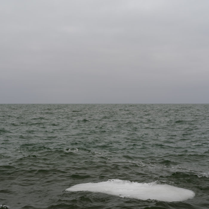 ice breaking up Contemporary art photograph of Lake Michigan, the inland sea, from Chicago by artist Lincoln Schatz