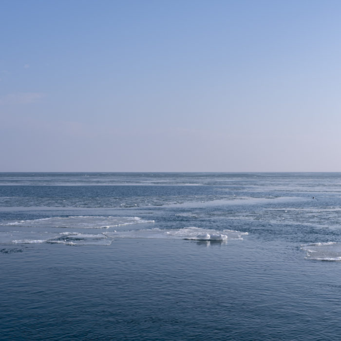 Ice moving on lake Contemporary art photograph of Lake Michigan from Chicago by artist Lincoln Schatz @lincolnschatz.com