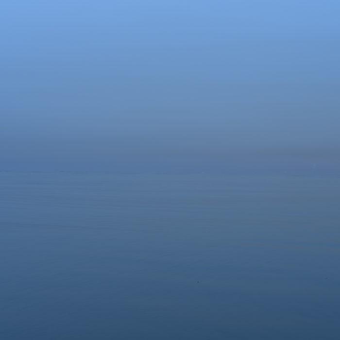 duck invisible horizon Contemporary art photograph of Lake Michigan from Chicago by artist Lincoln Schatz @lincolnschatz.com