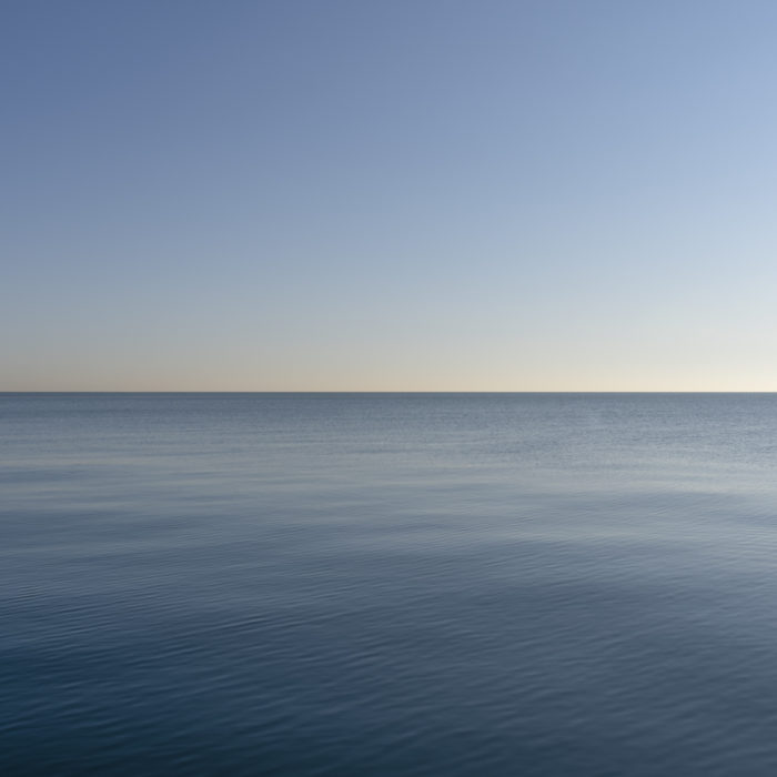 flat blue water and blue sky Contemporary art photograph of Lake Michigan from Chicago by artist Lincoln Schatz @lincolnschatz.com