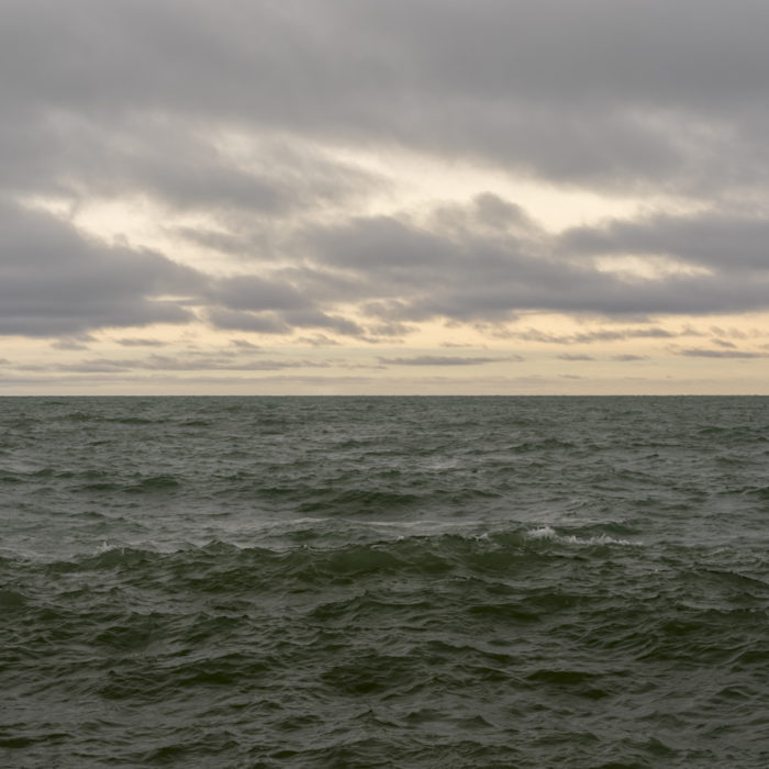 turbulent green water and clouds Contemporary art photograph of Lake Michigan from Chicago by artist Lincoln Schatz @lincolnschatz.com