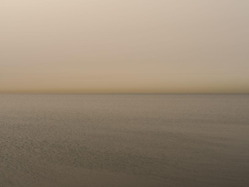 Pure orange light at dawn over Lake Michigan