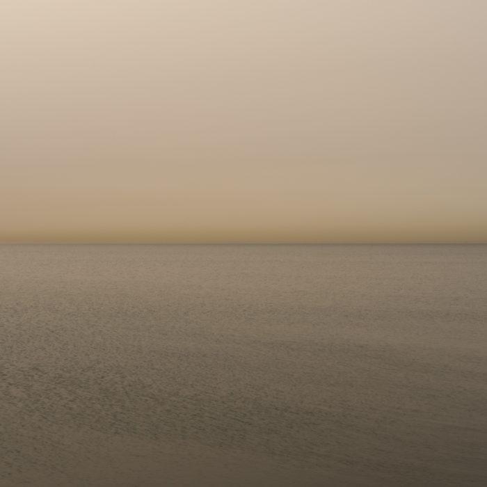 Pure orange light at dawn Fine art photograph of Lake Michigan from Chicago by artist Lincoln Schatz @lincolnschatz.com