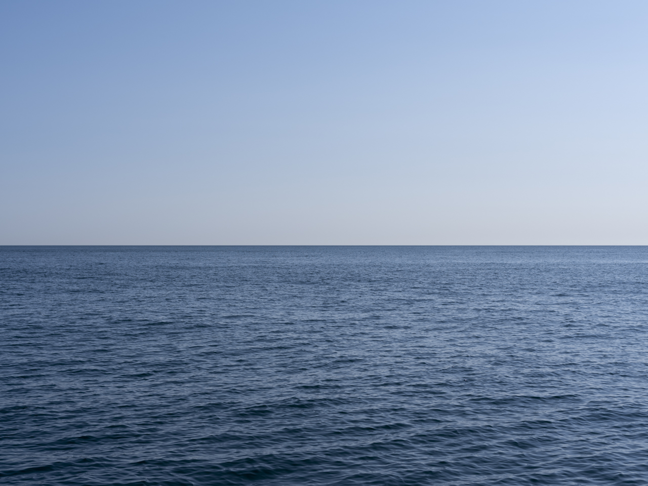 blue clear sky and slight waves on Lake Michigan