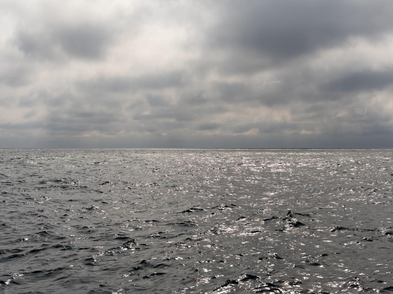 metallic and cloudy sky and lake