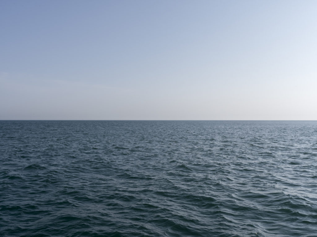 Fine Art Photography with a subtle chop on a cloudless day of Lake Michigan from Chicago by Contemporary Photographer Lincoln Schatz