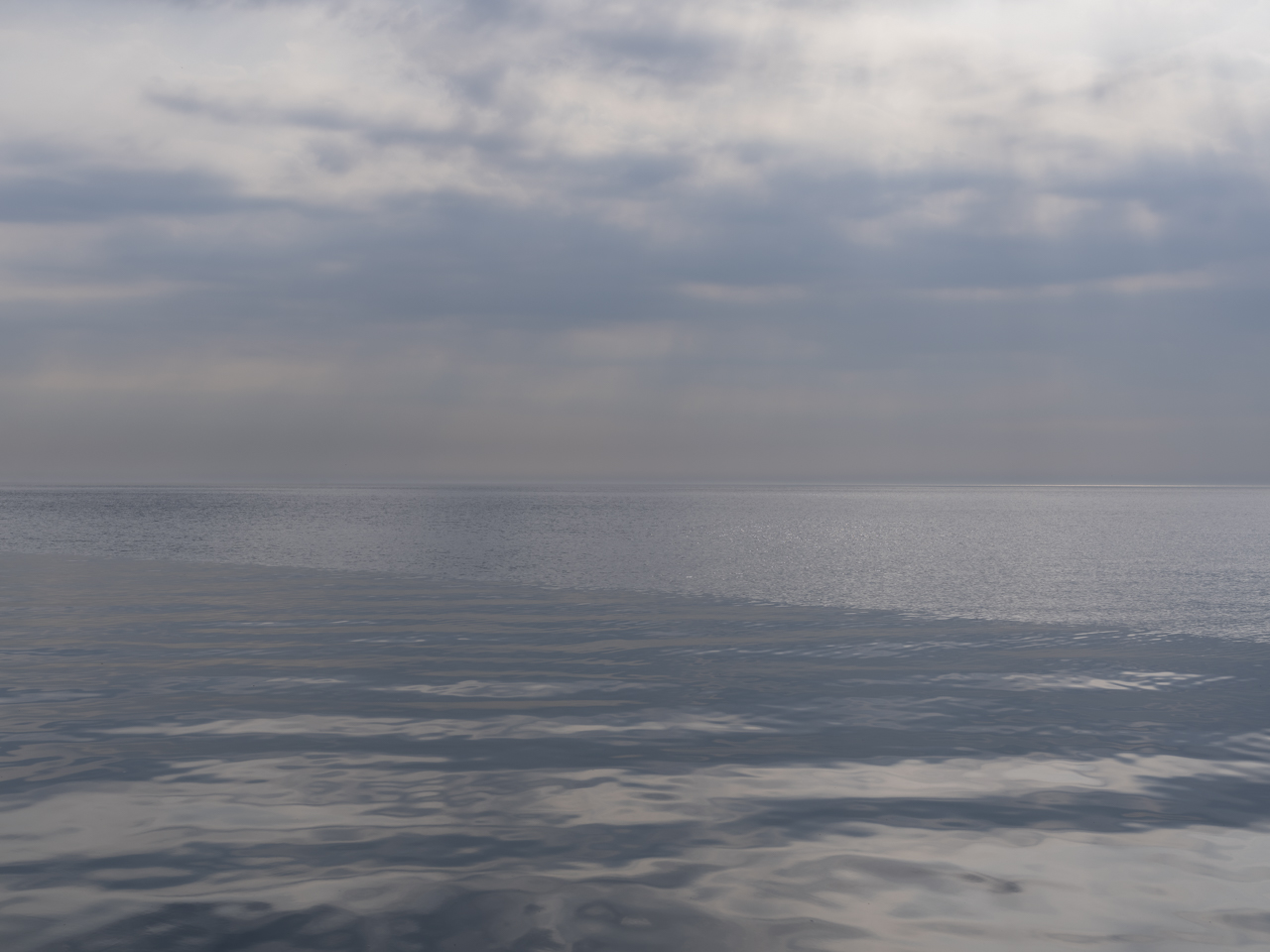 cloudy and hazy blue gray day over Lake Michigan