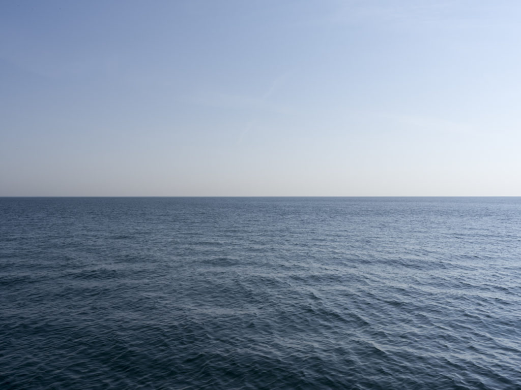 Fine Art Photography of Lake Michigan flat and enticing from Chicago by Contemporary Photographer Lincoln Schatz