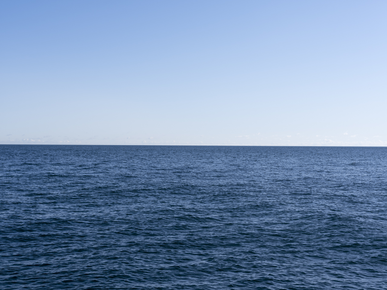 clear blue sky with deep blue water