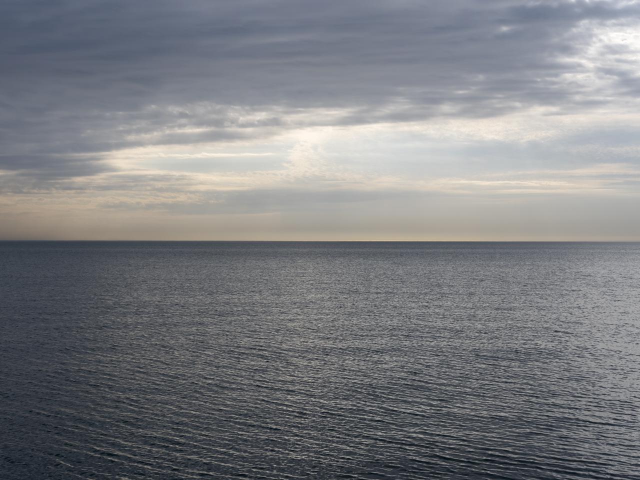 The sun emerges on Lake Michigan
