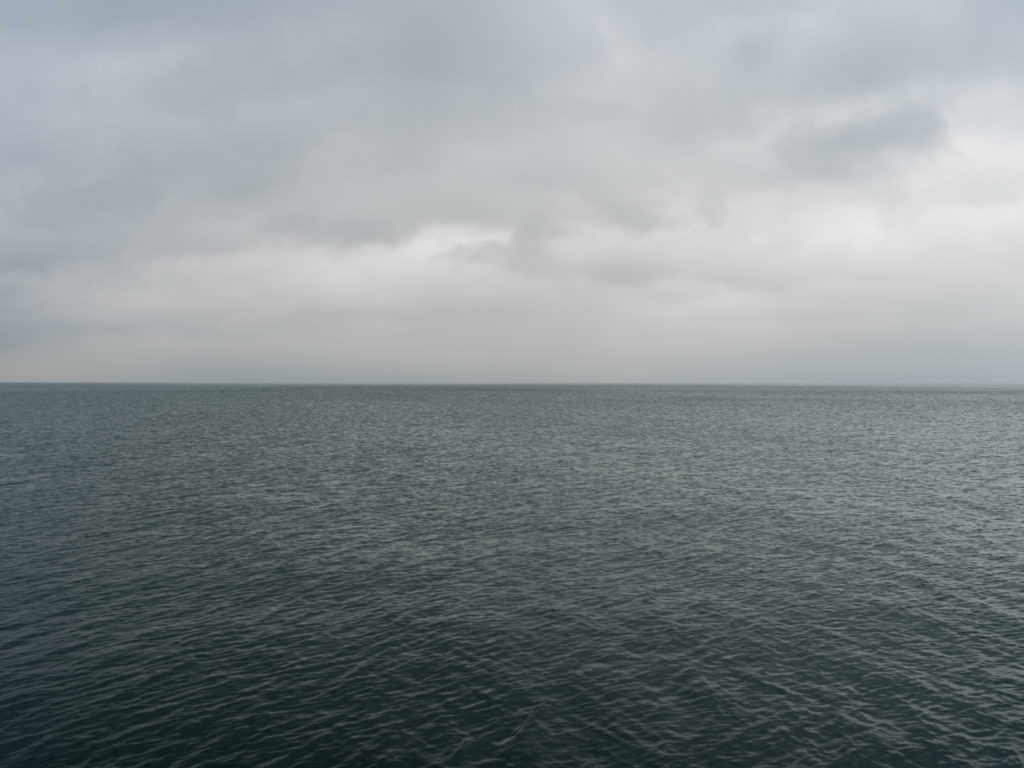 Fine Art Photography of Lake Michigan dark gray and slightly green extending outward from Chicago by Contemporary Photographer Lincoln Schatz