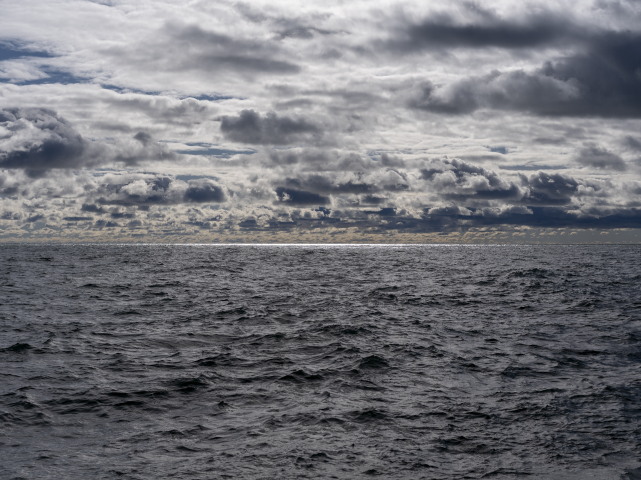 A stormy day over Lake Michigan with dark waves and clouds