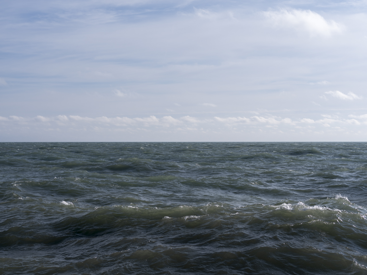 A windy day over Lake Michigan with waves