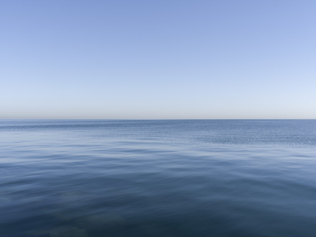 Fine Art Photography of Lake Michigan perfectly flat from Chicago by Contemporary Photographer Lincoln Schatz