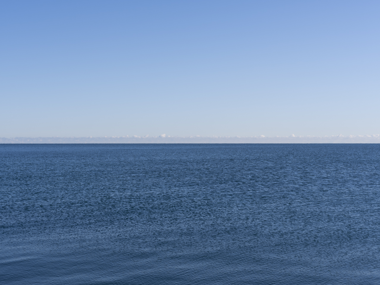 A clear blue sky over Lake Michigan