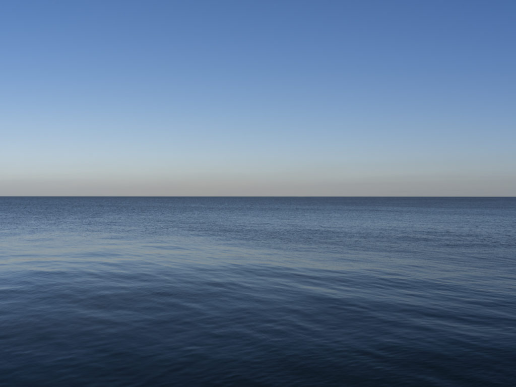 Fine Art Photography of Lake Michigan still with ripples offshore from Chicago by Contemporary Photographer Lincoln Schatz