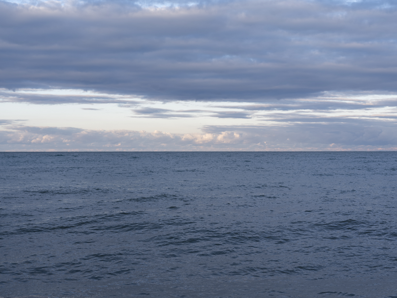 a very blue day on Lake Michigan with clouds and sun breaking through