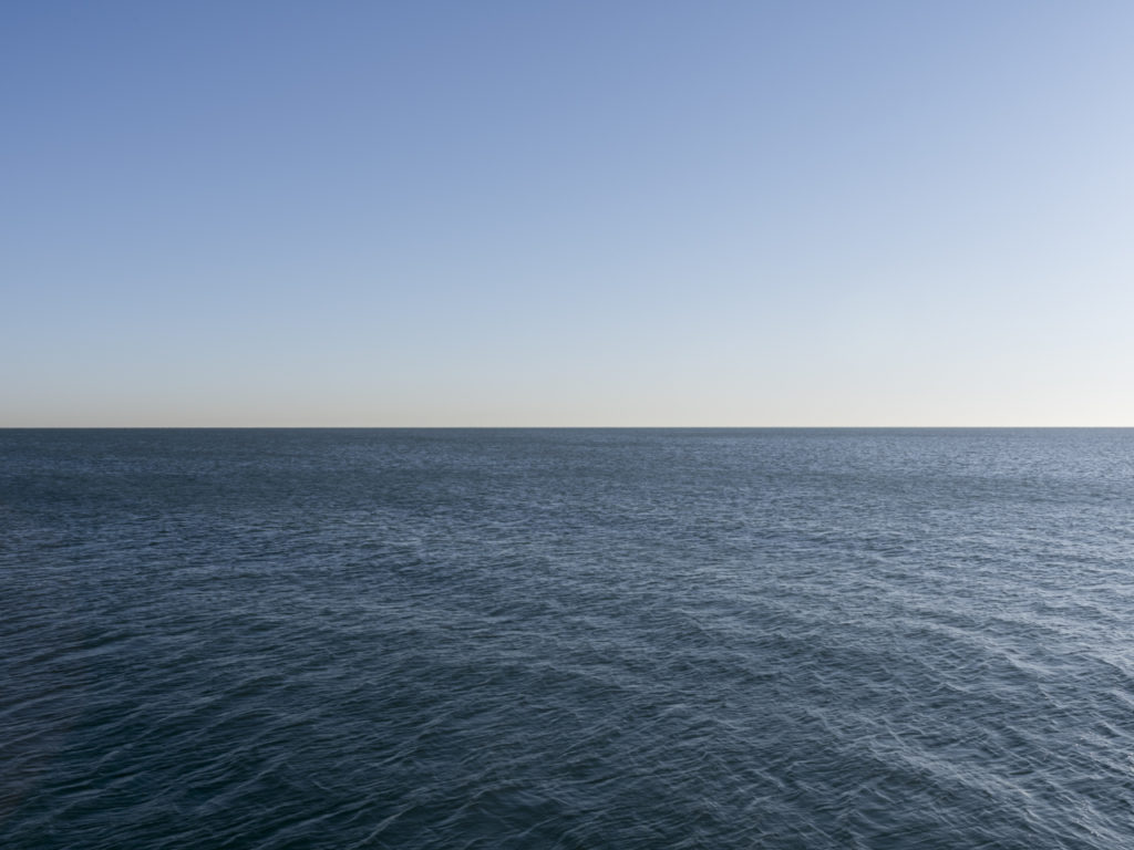 Fine Art Photography of Lake Michigan expanding far away from Chicago by Contemporary Photographer Lincoln Schatz