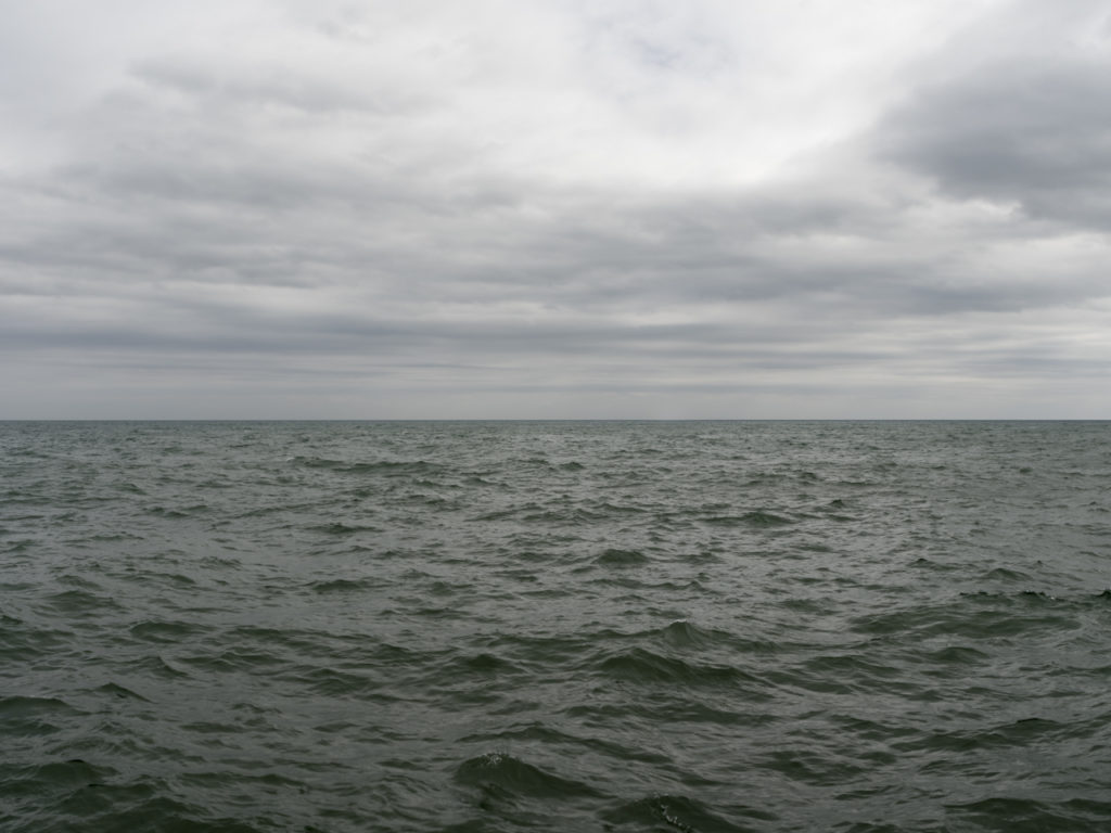 Fine Art Photography of Lake Michigan gray green with thick clouds from Chicago by Contemporary Photographer Lincoln Schatz