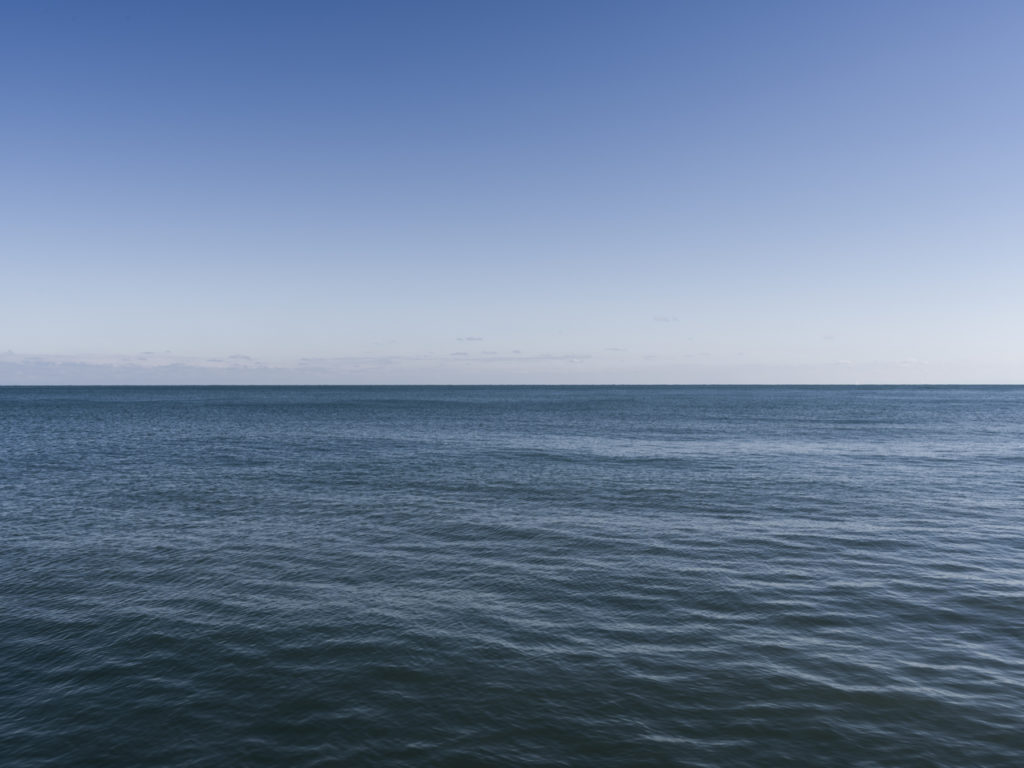 Fine Art Photography of Lake Michigan on a perfect clear day from Chicago by Contemporary Photographer Lincoln Schatz