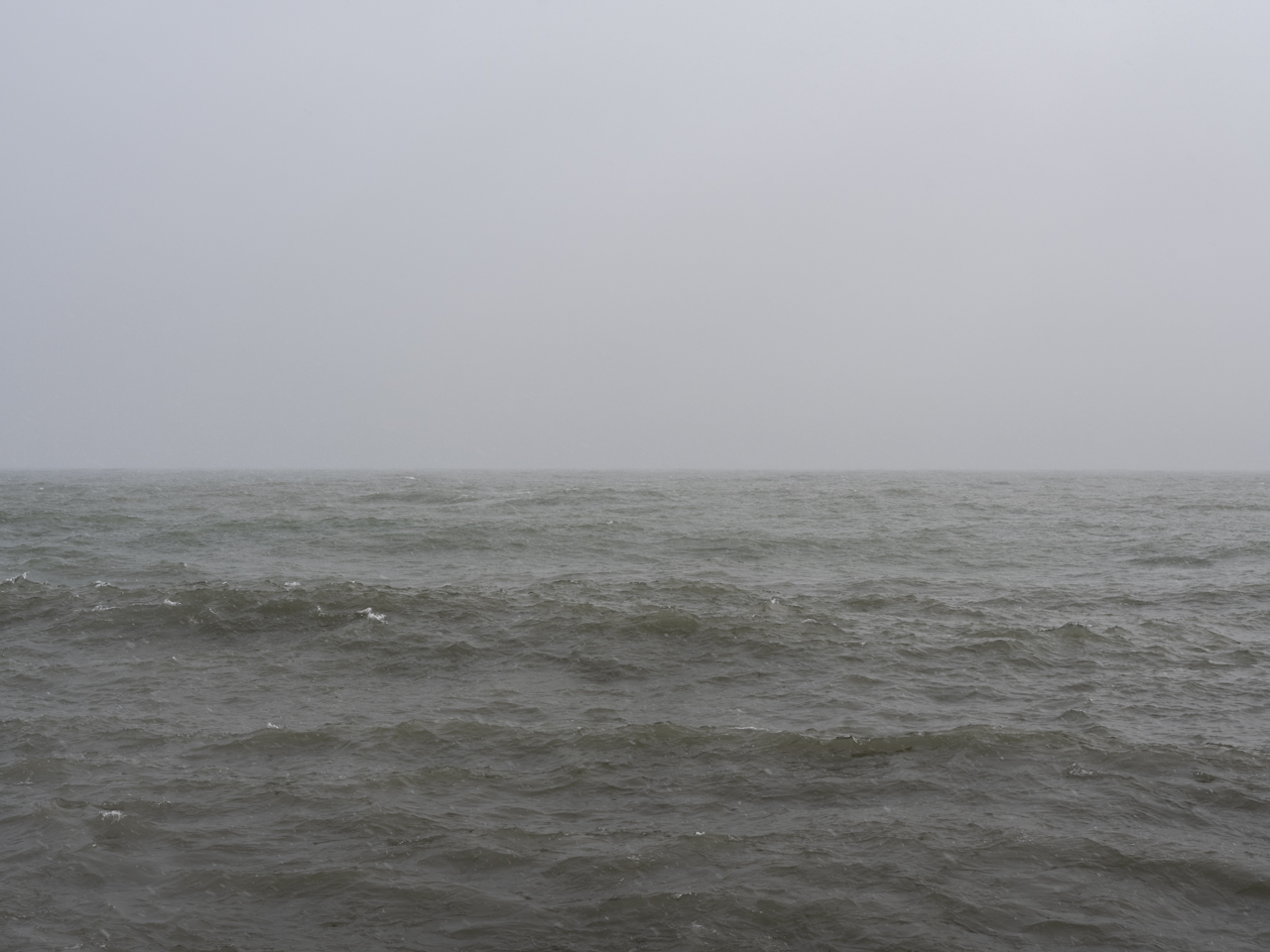A gray brown day with fog on Lake Michigan