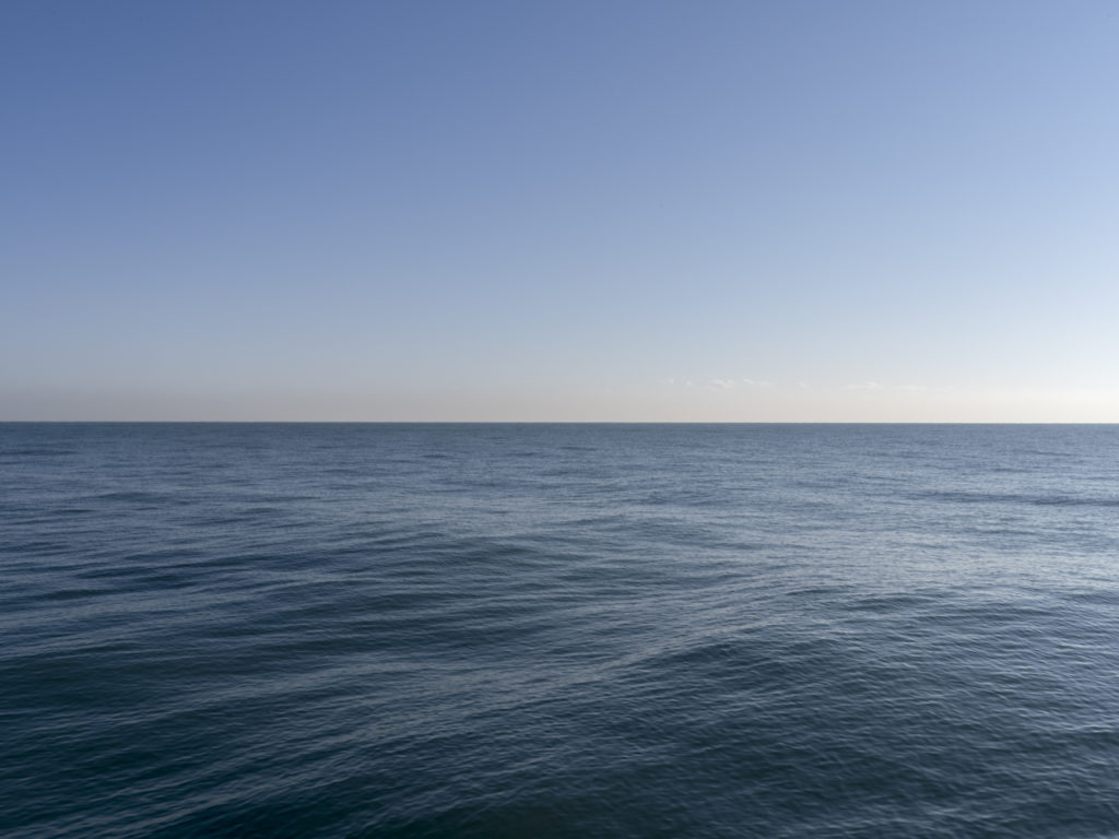 Fine Art Photography of Lake Michigan with slow rolling waves from Chicago by Contemporary Photographer Lincoln Schatz