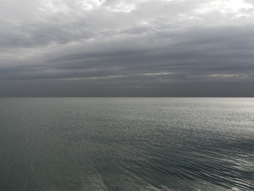 Fine Art Photography of Lake Michigan with brilliant light and dark diagonal clouds from Chicago by Contemporary Photographer Lincoln Schatz