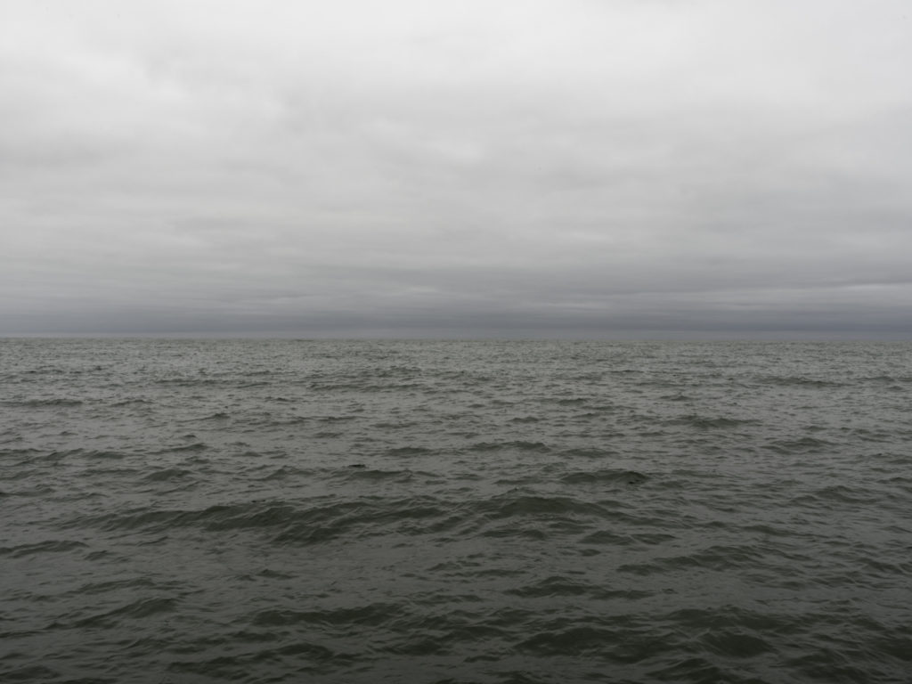 Fine Art Photography of Lake Michigan green gray with heavy overcast clouds from Chicago by Contemporary Photographer Lincoln Schatz