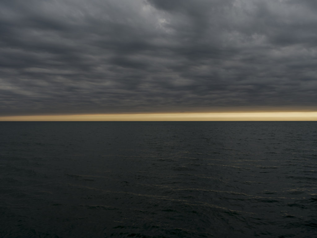 Fine Art Photography of Lake Michigan intense morning light with dark storm clouds from Chicago by Contemporary Photographer Lincoln Schatz