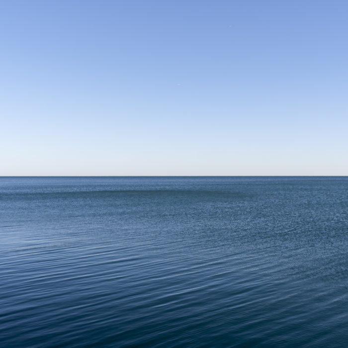 Fine Art Photography of Lake Michigan deep blue with rippled water from Chicago by Contemporary Photographer Lincoln Schatz