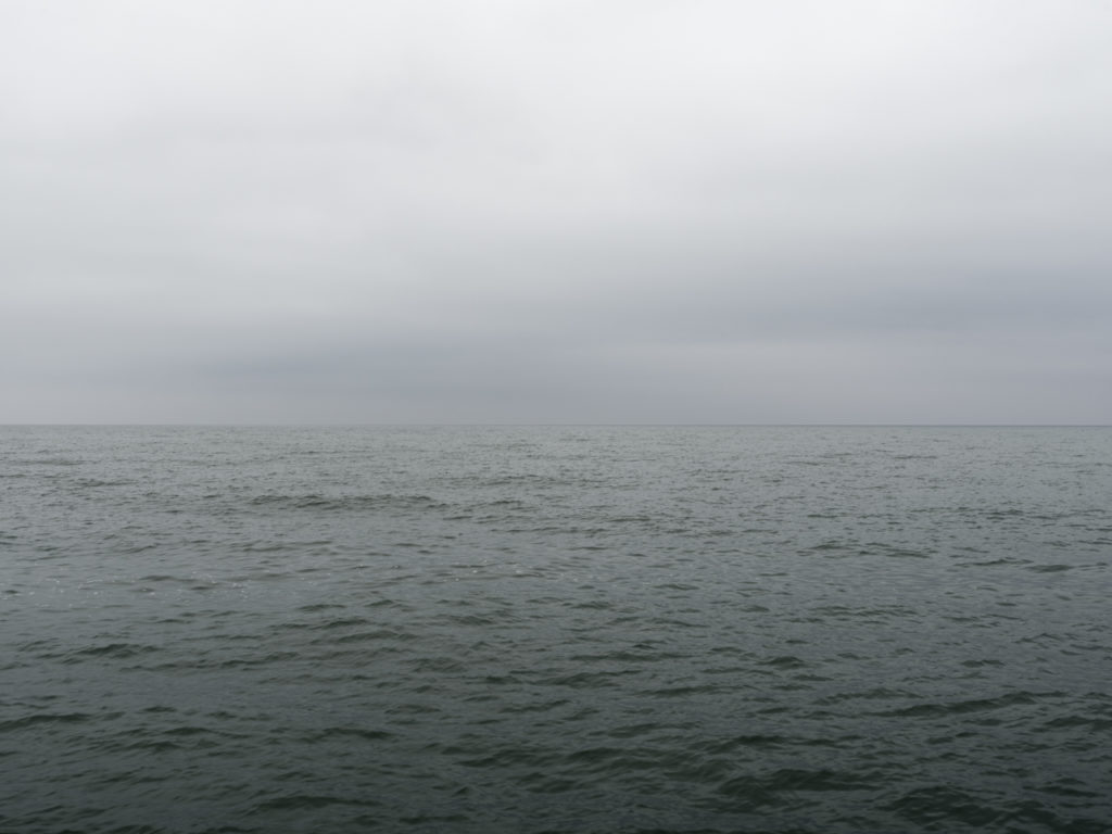 LFine Art Photography of Lake Michigan green water and gray sky from Chicago by Contemporary Photographer Lincoln Schatz