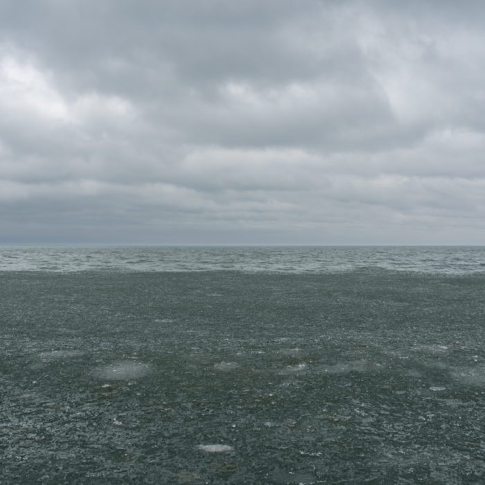 Fine Art Photography of Lake Michigan with green ice from Chicago by Contemporary Photographer Lincoln Schatz
