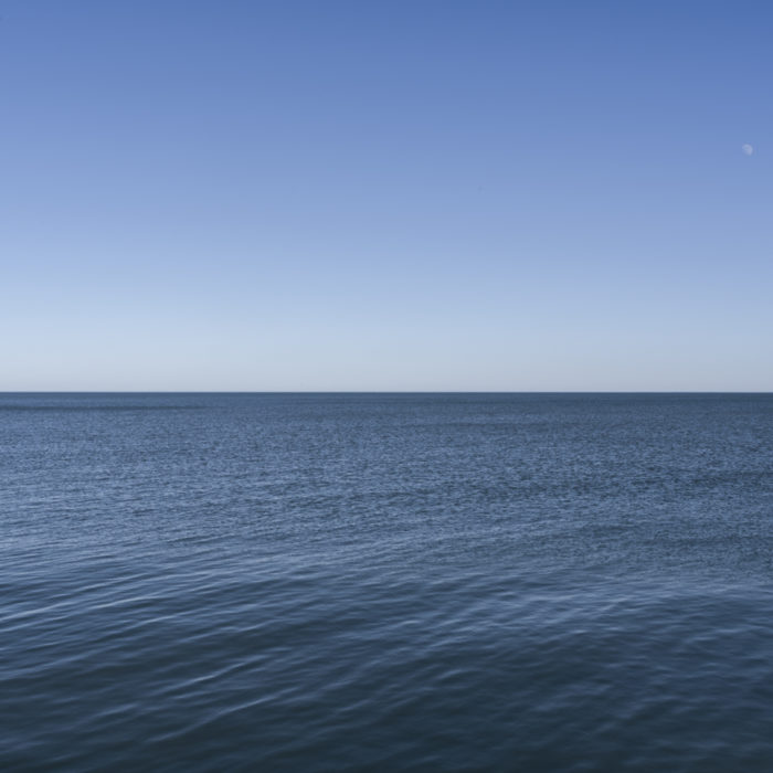 Fine Art Photography of Lake Michigan still with moon from Chicago by Contemporary Photographer Lincoln Schatz